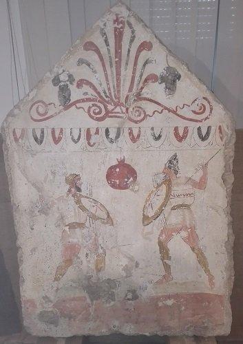 Dal Museo archeologico di Paestum, lastra tombale con melagrana.